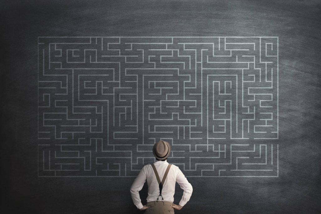 A Man looking at the Maze- Different business structures